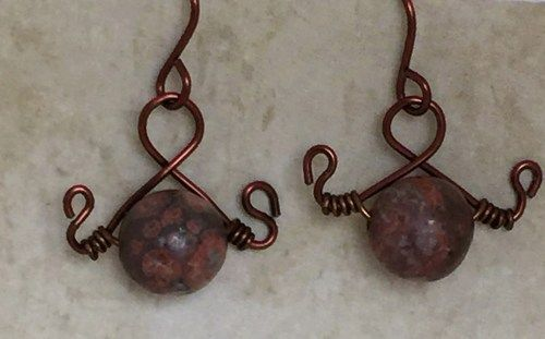 Red Agate Gemstone Earrings. I have wrapped these stones onto non- tarnish artistic wire The wire wrapped earrings feature red gemstones and measure just shy of 1 inch including the earwire.