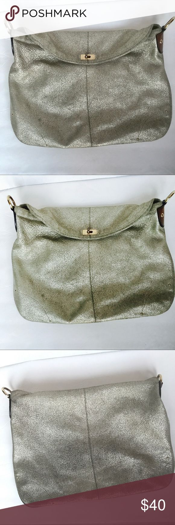 J. CREW Silver Metallic Leather Bag -Missing Strap This metallic silver shoulder bag with brown leather trim by J. Crew is previously owned in Very Good Used Condition. The shoulder Strap and Dust Bag are no longer available, however this bag can still be used as a great clutch.  DESCRIPTION: Metallic Silver Shoulder / Clutch Bag with Mineral Finish. Gold-tone hardware including the turn-lock mechanism. The interior is lined with beige fabric and includes a zip pocket. MEASUREMENTS…