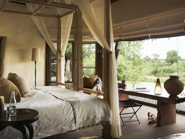 Singita Boulders Lodge is set in the exclusive Sabi Sand Private Game Reserve on the banks of the Sand River in the #Kruger. #africa #romance #beds #weloveafrica