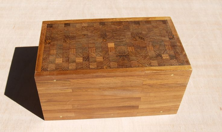 Teak End-grain Box by Frank Duyker. This box is made of reclaimed teak flooring. The lid features a panel made of end-grain squares while the brass pins originate from an 1895 organ keyboard.