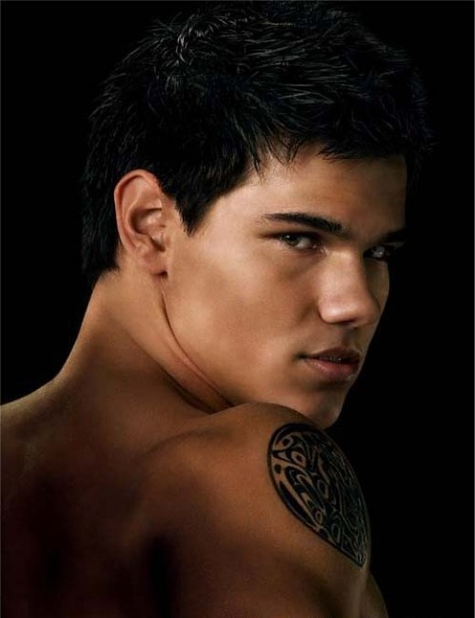 Taylor Lautner. Team Jacob all day. I dont even know the other ones name.