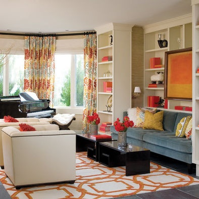 Graphic orange rug slate blue couch color combos for Bright coloured living room ideas