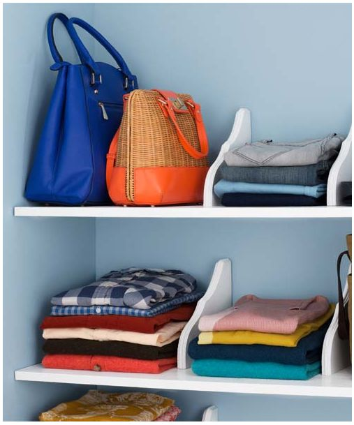 Use wooden wall mounts to add cute dividers for your closet to break up large shelves and avoid clutter.