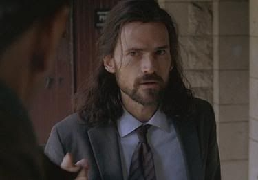 """4.05 """"The Constant"""" – Professor Daniel Faraday at Queens College Physics Department, Oxford University, in 1996. He's looking doubtfully at Desmond because they've never met before. And Desmond hasn't even told him the part about having been to the future yet!"""