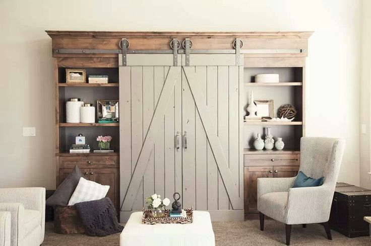 Love this entertainment center with sliding doors- perfect hardware and stain combination
