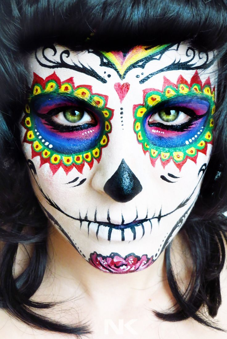 Sugar Skull Face paint tutorial. Dia de los muertos (Day of the Dead) --- I don't normally like Sugar Skulls but this one is really pretty and has more of an elegant factor. This video is cool to watch too it's more time lapse than tutorial. Who knows maybe I'll wear one, one day. X):