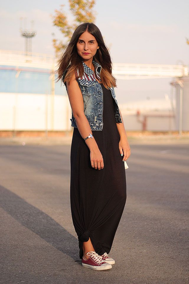 Denim vest with maxi dress and converse. Funky.