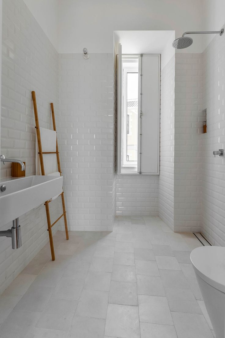 This house is in the historic neighborhood of Mouraria  Lisbon  and suffered many transformations over. 78 Best ideas about White Tile Bathrooms on Pinterest   White