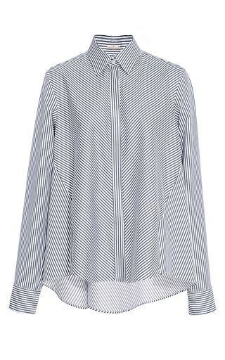 This **Adam Lippes** shirt features a button up style with a pointed collar and a relaxed fit.