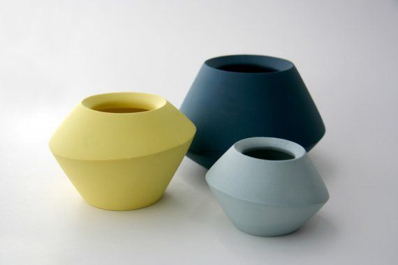 Love the soft colors of these ceramic vessels.