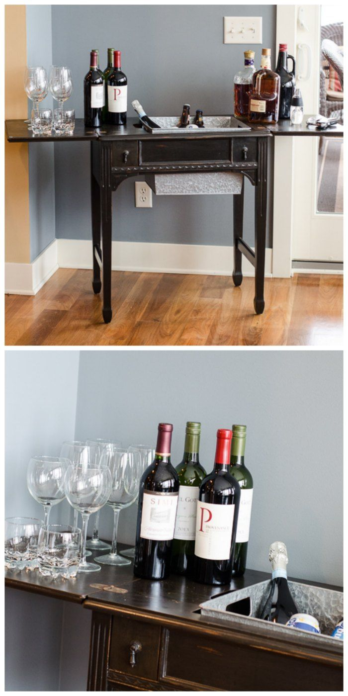 Take an old sewing machine table and give it new life by turning it into a bar cart! Add a galvanized steel container in the opening, and you've got a great spot for ice and drinks.