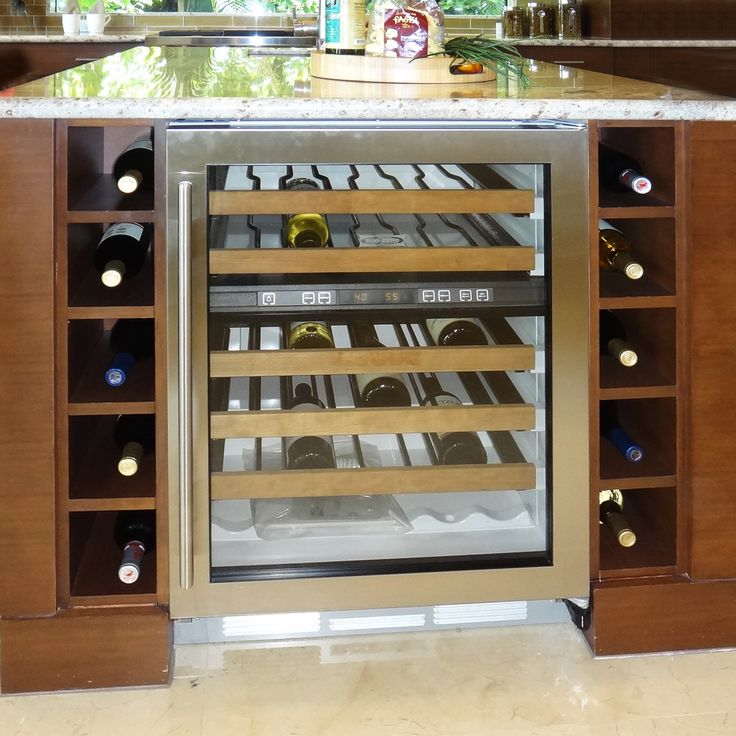 A Wine Rack And Cooler Right At The End Of A Kitchen Island Is A Great Feature For Those Who