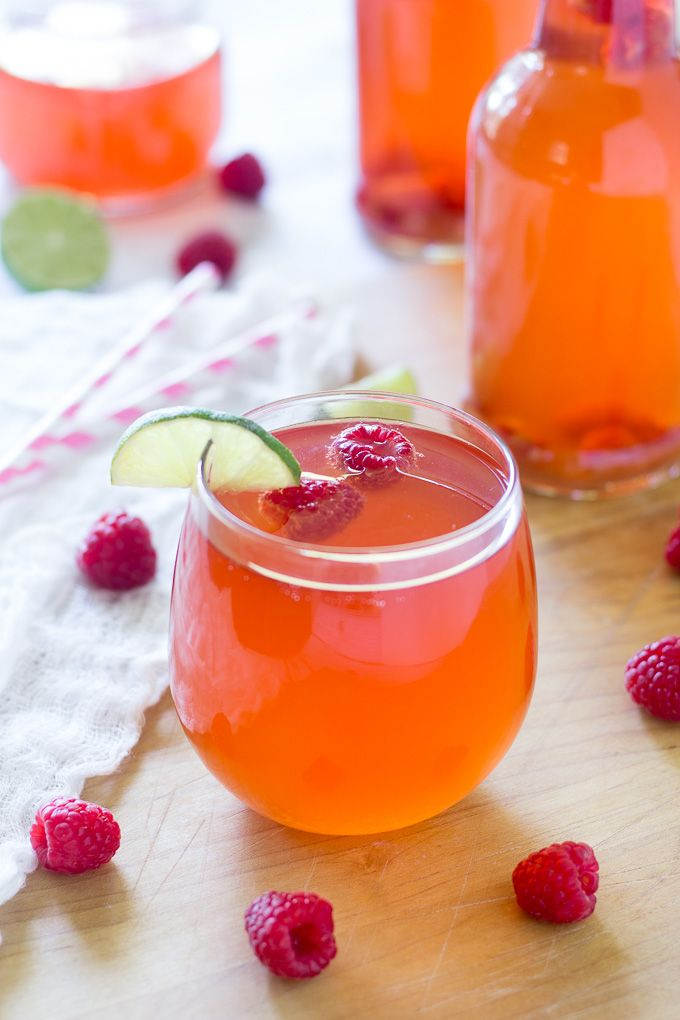 Recipe for a delicious, tart and sweet homemade kombucha flavored with fresh raspberries and lime juice. Great way to get probiotics and Whole30 friendly
