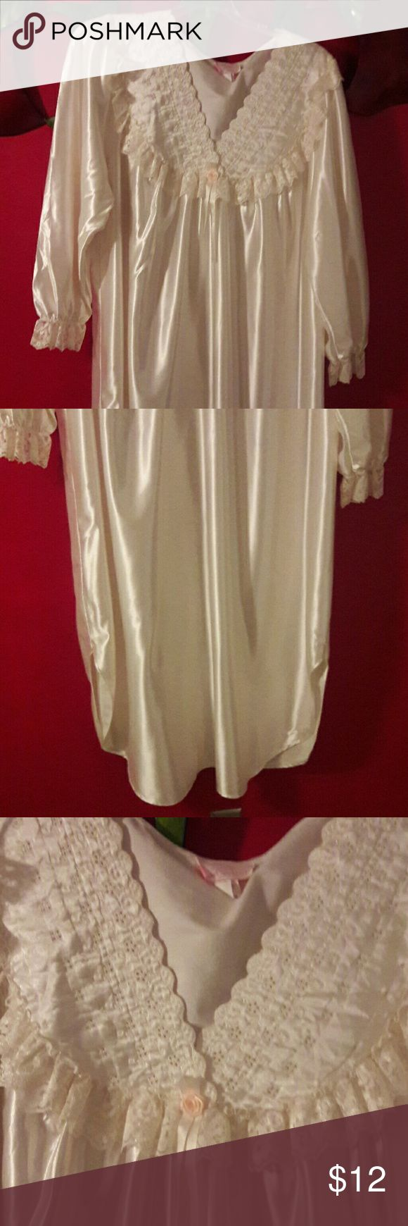 Beautiful Vintage Gown *** Good Condition *** V-Neck. Long sleeves. 100% Polyester. Eyelet and lace trim. Only damage is shown in picture #4, 1 1/4 inches on the side is open. Beautiful ivory color. Sears  Intimates & Sleepwear