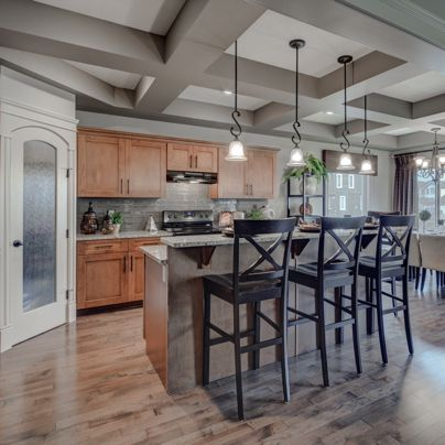 Madison E Kitchen - love the raised eating bar and #coffered ceiling