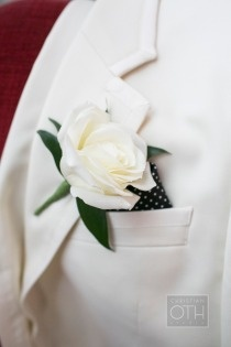 White rose button hole for groom