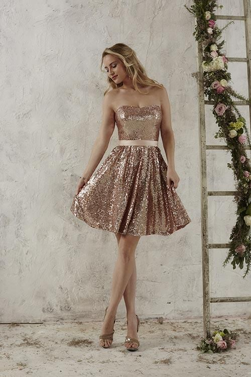 Balletts Bridal - 22906 - Bridesmaids by Jacquelin Bridals Canada - A short gown glimmering in sequins, this design is complete with a ribbon waistband, semi-sweetheart neckline, and spaghetti straps. Pictured In: Rose Gold/Blush Pink