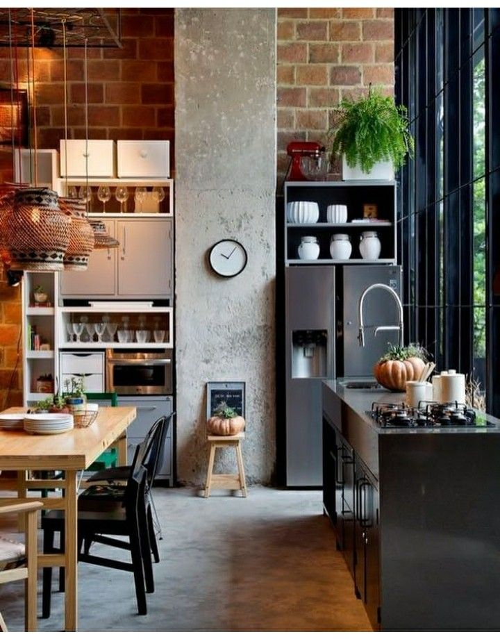 Fantastic soft-industrial kitchen here, love the use of concrete and the mix of open and closed shelves. #openshelves #closedshelves #industrialkitchen #creativekitchen #basketlights #basketlamps #oniginalkitchen #kitchen