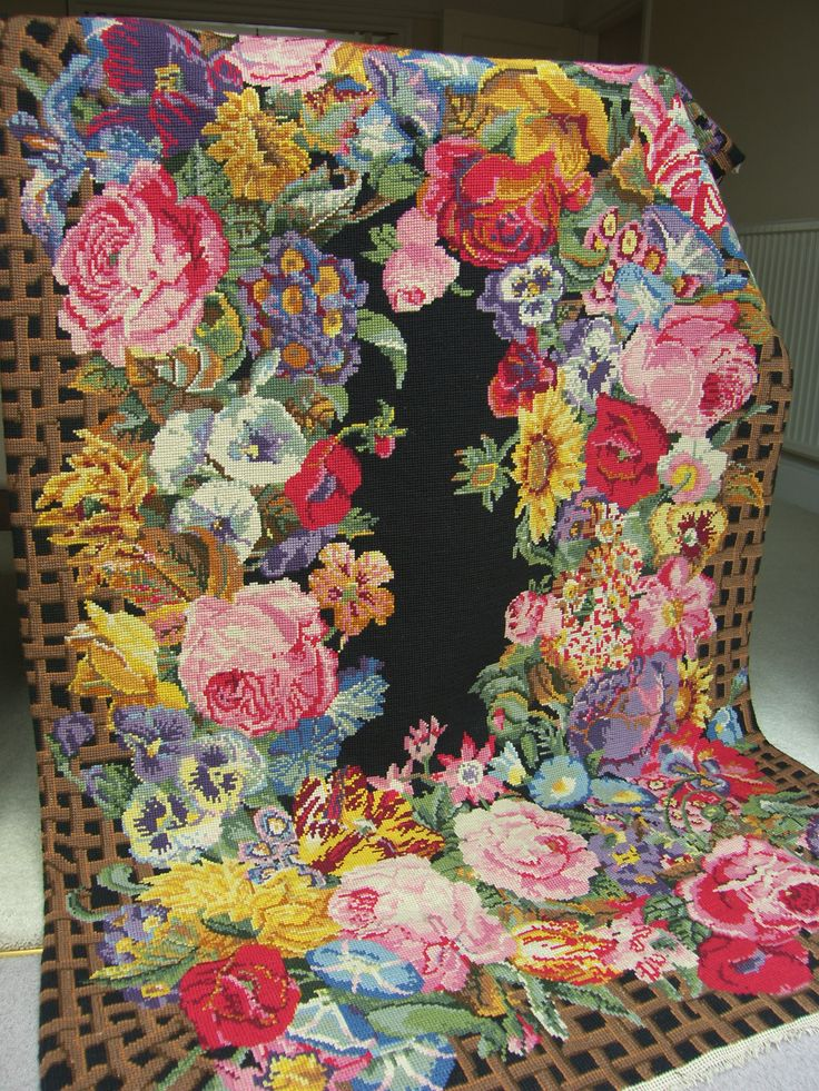 needlepoint floral rug with a visual joke (check the edges of the design)