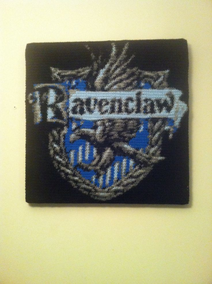 Crochet Ravenclaw crest finally finished and mounted! My first big crochet by numbers project.