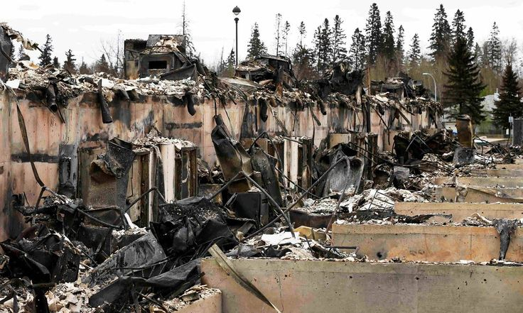 Rachel Notley describes devastation wrought by ongoing wildfire as 'heartbreaking', with residents facing long wait to return to their homes