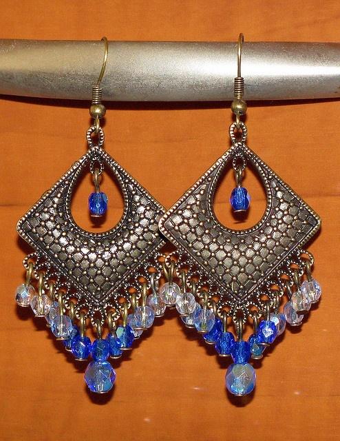 Blue diamond earrings, via Flickr.