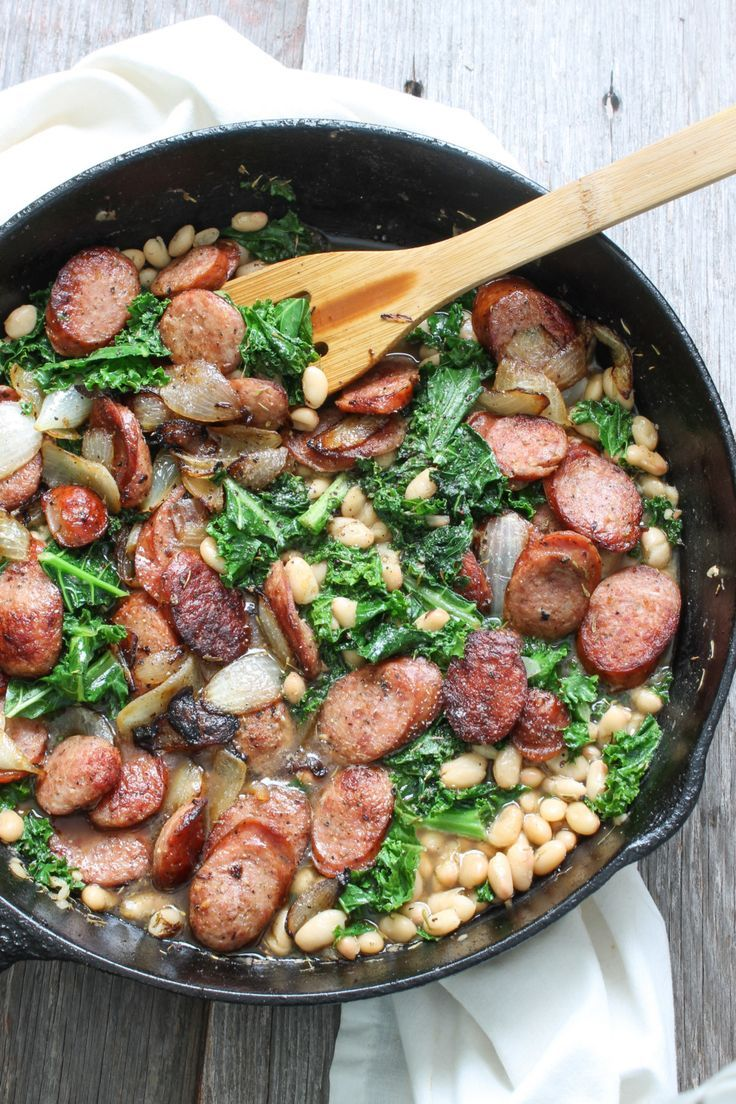 Contains spicy chicken andouille sausage (other sausage works fine), cannellini beans and fresh greens flavored with a sprig of thyme and a splash of balsamic vinegar.