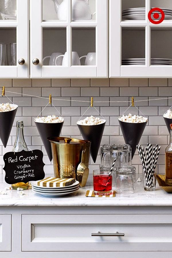 Popcorn Bar ideas for an Oscars/Academy Awards viewing party; Party hats turned upside down...love it!