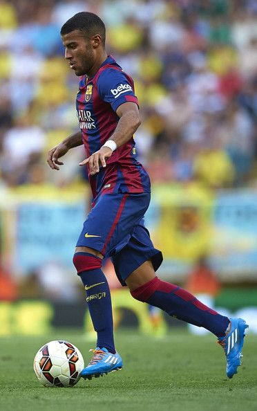 Rafinha of Barcelona runs with the ball during the La Liga match between Villarreal CF and FC Barcelona at El Madrigal stadium on August 31, 2014 in Villarreal, Spain.