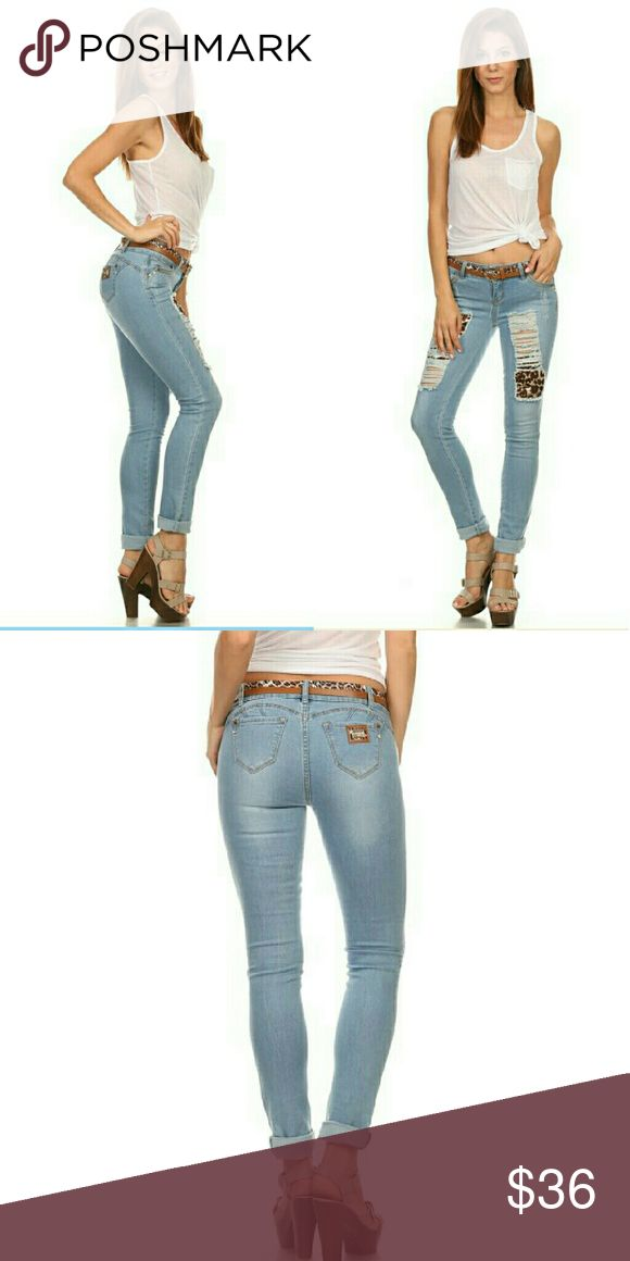 Light blue distressed  jeans pants Nice light blue wash Stretch denim destroyed with leopard animal print patches ZIP fly button closure pockets detachable two tone brown and leopard belt butt lift design folded leg golf hardware Premium quality material fit juniors and Young Ladies size 0 to 15 Content  80%cotton 18%Polyester 2%Spandex Clash  USA Jeans Skinny