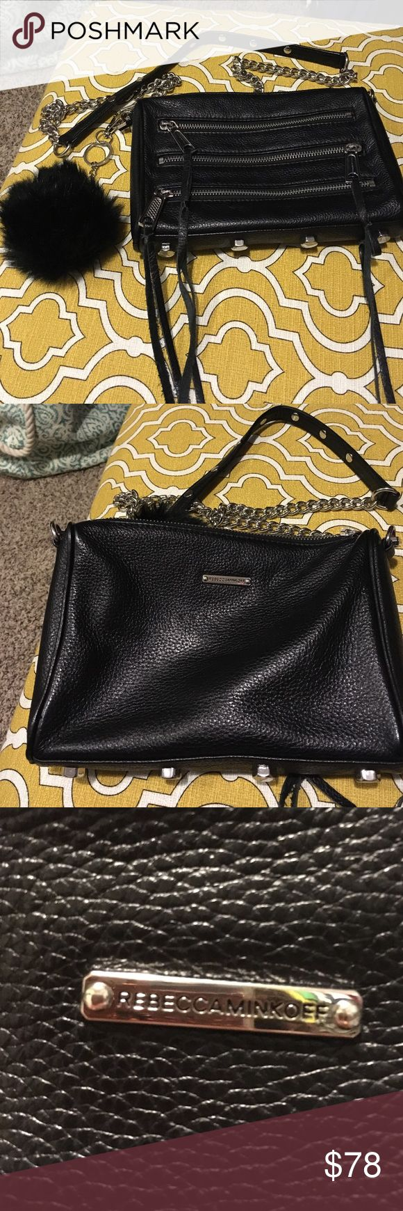 Rebecca Minkoff Purse Great condition!.. super cute purse with the leather fringe on zippers and fur ball! Rebecca Minkoff Bags Crossbody Bags