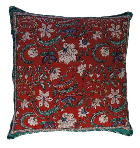 Printed natural cotton floral pattern cushion in red and green with a hint of blue and yellow. The reverse has a complimenting repeated floral design in the same colours.  Hand block printed in India using ethical and environmentally friendly construction that preserves and celebrates traditional artisan skills.  100% natural cotton cover with NZ made Polyfill inner.  Dimensions: 45cm x 45cm