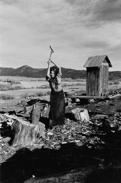 Tough desert woman chopping wood