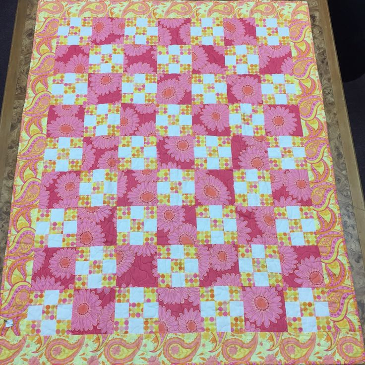Why not make a QUICK and EASY little quilt for that baby arriving this Spring? With @AccuQuilt GO! Cutters and GO! Qubes you don't need a pattern, just choose Spring fabrics, cut your babric block shapes and GO!