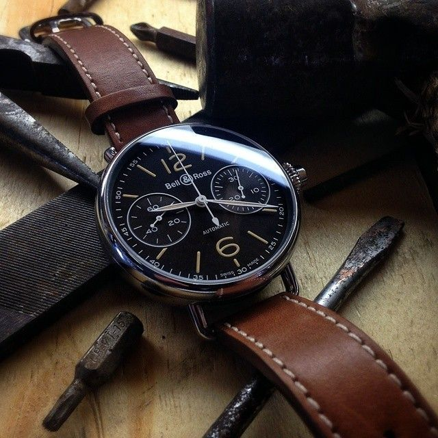 Not many watches can match the simple but unique look of the Bell Ross Vintage WW1Chronographe Monopoussoir. This masculine, self winding timepiece features a 45mm polished stainless steel case which dovetails magnificently with its brown dial and brown calfskin leather strap, giving the watch a refreshingly unique and elegant appearance. The dial features luminescent feuille hour and minute hands with brown in-fill and two highly legible chronograph subdials at 3 and 9 oclock.