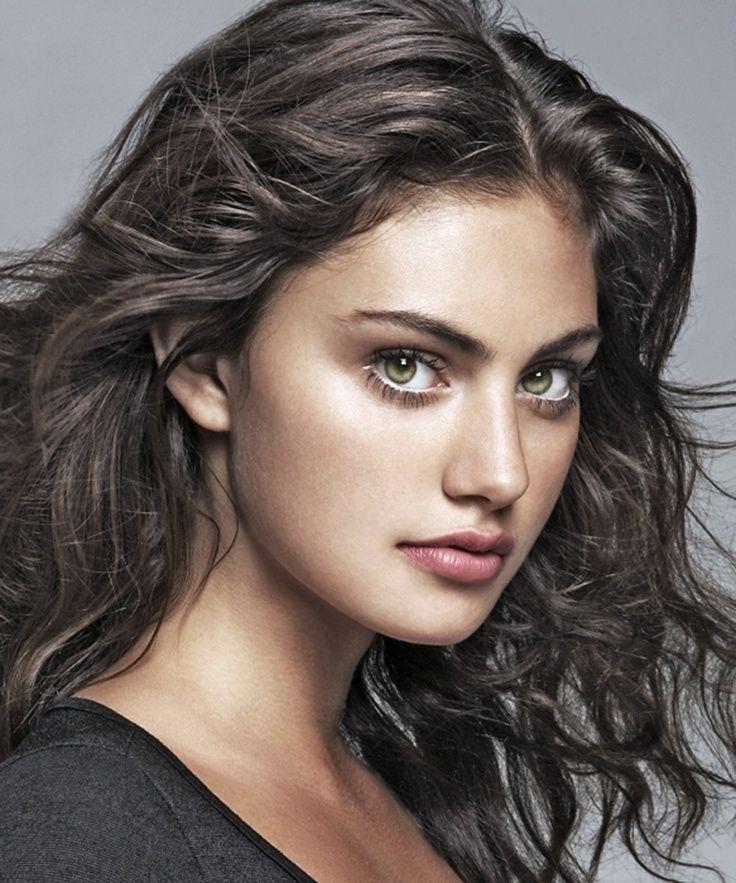 Darker hair with hazelgreen eyes and warm skin tone make