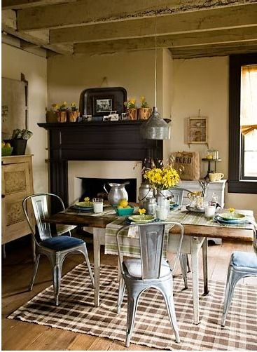 Kitchen table in center leaves room for fireplace in corner