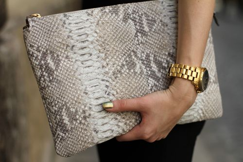 Over-sized clutch, large gold watch, and metallic gold nails- love it.