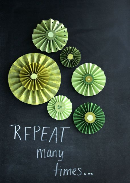 Tutorial for making paper pinwheels - I'd love to make a garland using these.