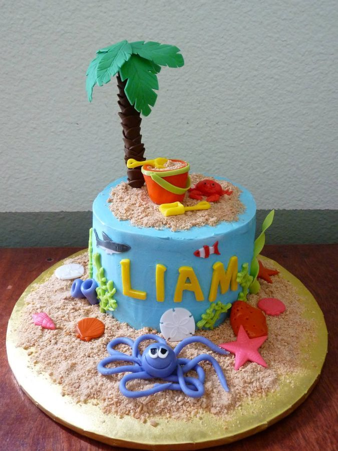 Chocolate cake with Swiss Meringue buttercream for a 1st birthday with Palm Tree and Sand Bucket theme.