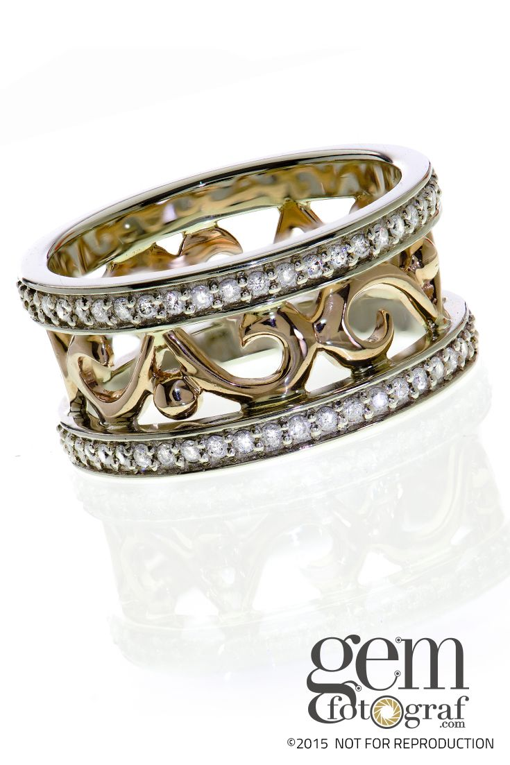 The striking contrast of yellow gold, white gold, and white diamonds is a stunning combination with a modern look.