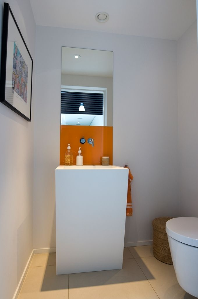 Villa Design Presenting Modernistic Simplicity : Small White Bathroom Interior Among Little Accent From Orange Colours With Beige Concrete Tile Flooring Under Minimalist Interior Decoration Design