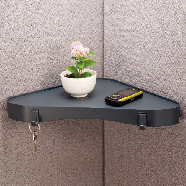 Increase your space by adding a corner shelf in your cubicle. | 34 Ways To Make Your Cubicle Feel Like Home