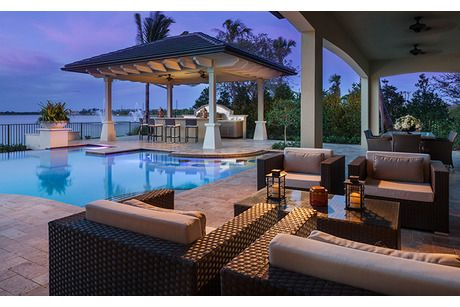 Watercrest At Parkland - Horizon Collection by Standard Pacific Homes in Parkland, Florida - Bar seats in the pool by the cabana