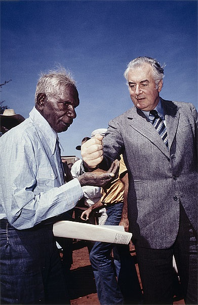 Prime Minister Gough Whitlam pouring soil into the hands of traditional owner Vincent Lingiari, 1975.