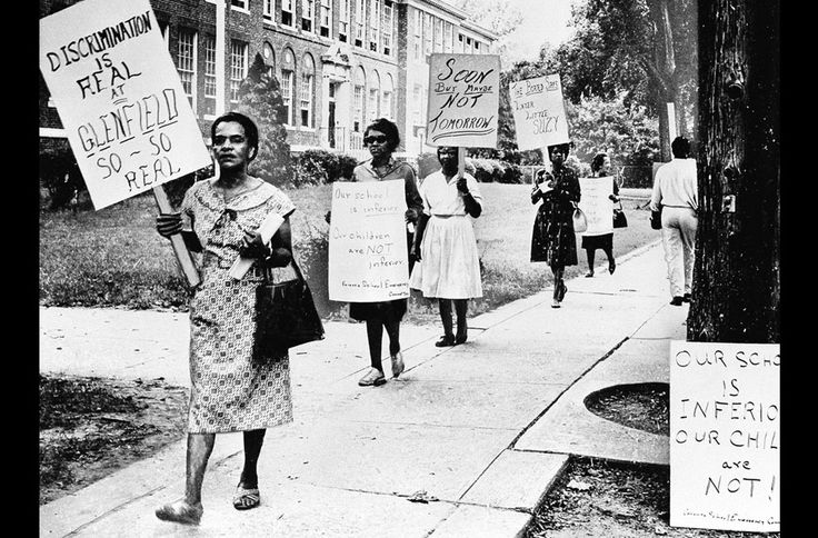 Fighting for equality in American education, parents of students picket Glenfield Junior High School in Montclair, New Jersey, to dramatize their effort to improve education for the school's students, 90 percent of whom are African-American. Later, on August 22, 1962, the school board decided to divide Glenfield's 182 students among the wealthy suburb's three other high schools.