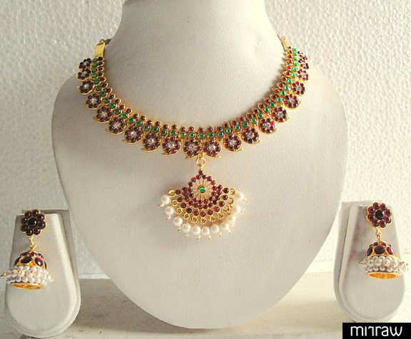 The jewel set includes A Necklace A pair of earrings The jewel is studded with simulated pearls, maroon-green stones The jewel is made up of high end alloy.