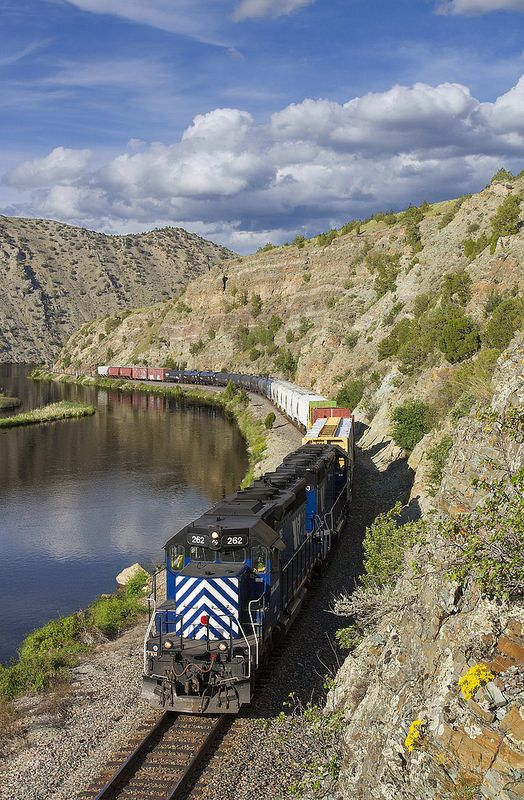 Lovely Lombard - Montana Rail Link's Helena Local rolls east along the Missouri River in Lombard Canyon just west of Lombard, Montana, on a gorgeous afternoon. The Local, which usually comes through here mid-morning, was running on a later schedule (and on Sunday) because of a work window in the canyon. Two beautiful SD40s (SD40-2XRs) lead the train.