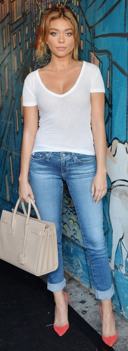 Sarah Hyland: Purse – Saint Laurent  Shoes – Manolo Blanik  Jeans and shirt – AG