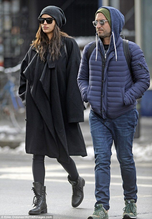 The 31-year-old model - who is believed to be engaged to actor Bradley Cooper - wore a stylish charcoal coat over an oversize sweater and leggings as she strolled with a male companion